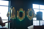 "Gold ""100"" balloons"