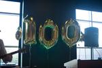 "Gold ""100"" balloons"