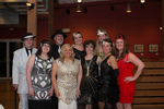 Caregivers dressed as flappers and gangsters at Centennial Celebration