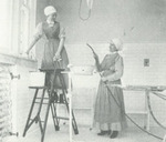 Student nurses cleaning surgical room
