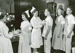 Nursing program graduation showing first male nurses