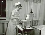 Nurse with hot towels