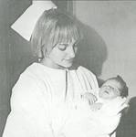 Nurse holding infant
