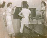 Nurses around autoclave
