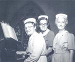 Sisters at piano