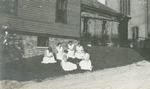 Student nurses seated outside nurses' dormitory