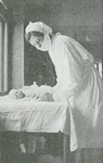 Masked nurse with infant