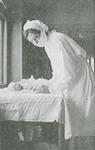 Masked nurse with infant